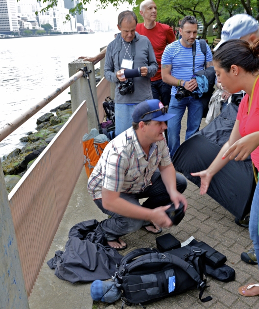 Mentor Lucas Gilman unloads camera gear on Roosevelt Island for outdoor shoot.