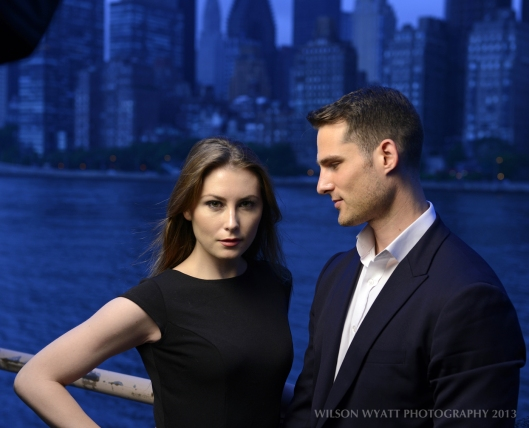 Portrait of professional models Andy Mizerek and Nastasia at night with New York background, taken from Roosevelt Island.