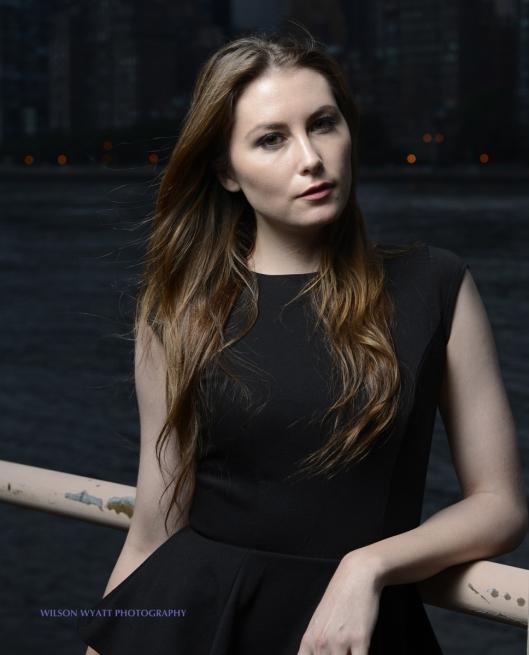 Outdoor portrait of professional model Nastasia at night against the Manhattan skyline, taken on Roosevelt Island.