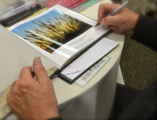 "Signing ""Chesapeake Views - Catching the Light"" - Photo by Katie Wyatt"